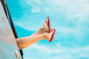 100 best road trip songs | Woman's Feet Hanging Out Car Window